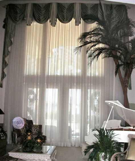 swag curtains for large windows a large window traditional window treatments