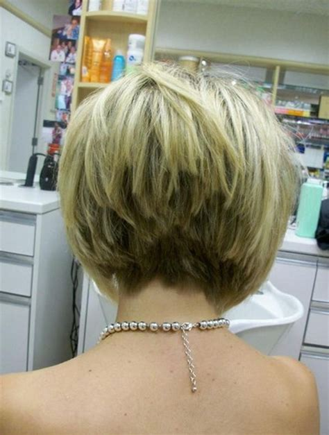 hair style short and stacked on top and long agled sides longer back stacked short haircuts for women