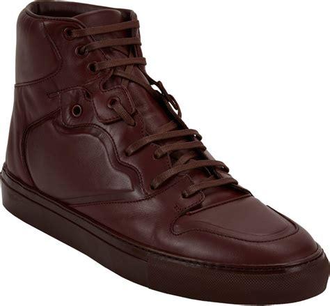 brown balenciaga sneakers balenciaga paneled high top sneakers in brown burgundy