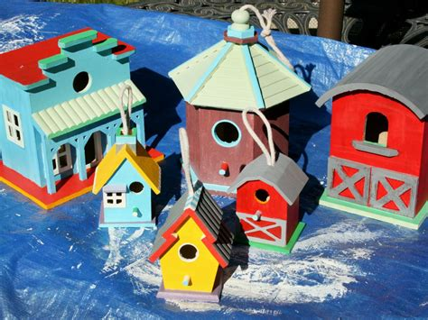 decorate a fence with birdhouses hgtv