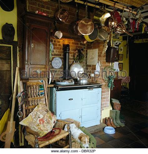 copper pans  rack  white aga  cottage kitchen