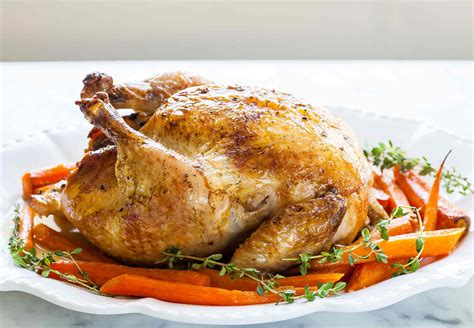 roasted whole chicken roast chicken with carrots recipe simplyrecipes com