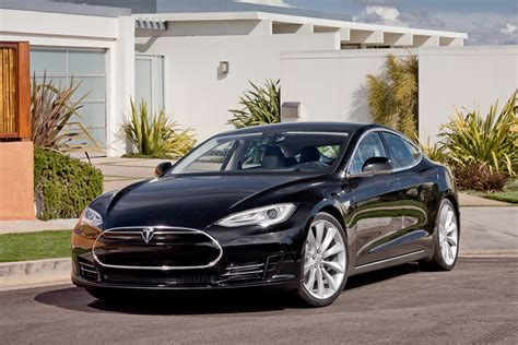 Tesla Electric Car Pictures Tesla Motors Takes Eco Friendly Driving To The Next Level