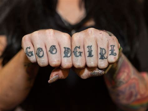 good girl tattoo about knuckles