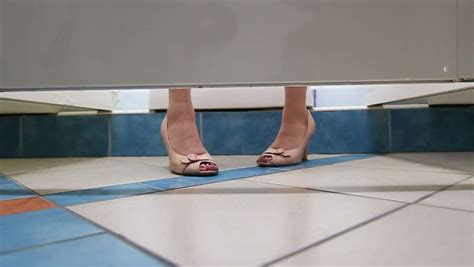 feet under bathroom stall closet stock footage video shutterstock