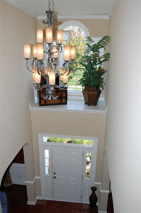 foyer ledge decorating ideas two story foyer with shelf above door with window what