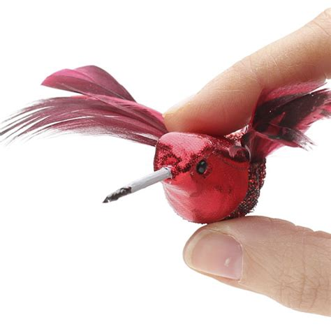 red glitzy artificial hummingbirds birds and butterflies