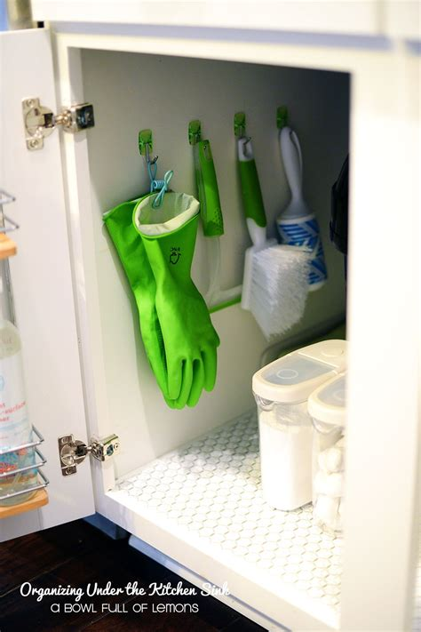 organize bathroom sink cabinet organizing under the kitchen sink i must do this our