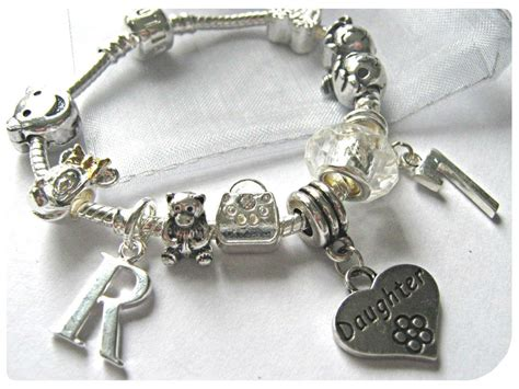 7 Pretty Charms For Your Daughters Charm Bracelet by Childrens 7 Quot Initial Letter Age Silver