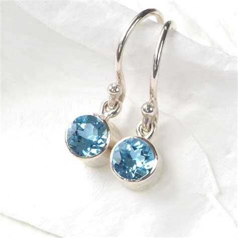 december birthstone earrings blue topaz by lilia nash