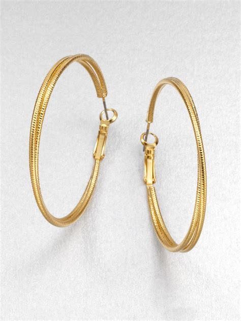 Allen Dons Gold Ribbed Hoop Earrings A La Hilary Duff abs by allen schwartz twisted textured hoop earrings in