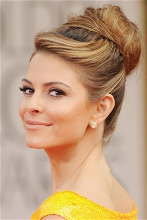 pic of black side swept bangs and bun hairstyle the high bun with side swept bangs vow magic