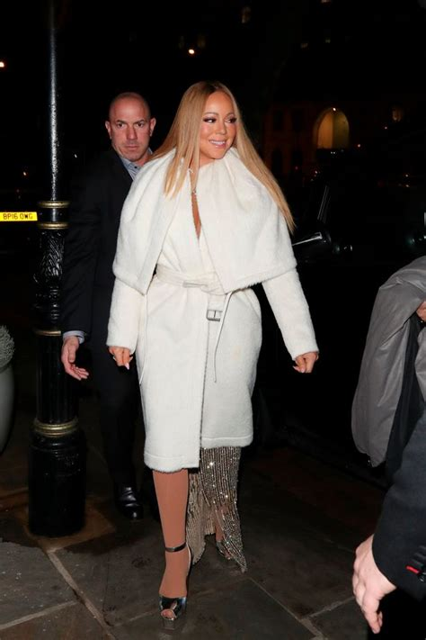 Carey Prances Out Of Hotel by Carey Almost Spills Out Of Dress As She S