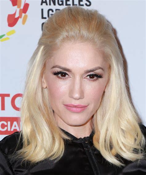 gwen stefani hairstyle medium blonde curly hairstyle with bangs gwen stefani medium straight casual hairstyle light