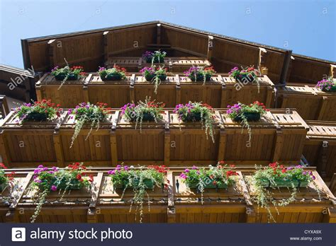 houses to buy in austria typical house in austria with a lot of flowers hanging on the stock photo royalty