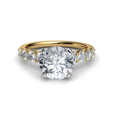 graduated side engagement ring in 14k yellow
