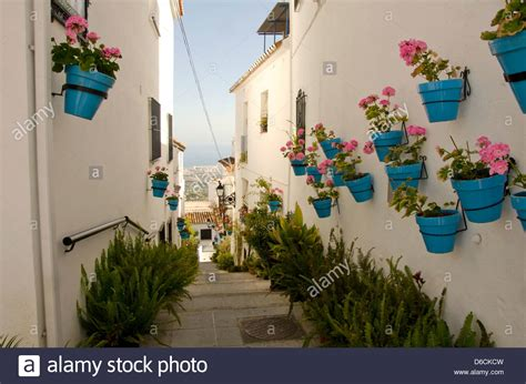 planters that hang on the wall hanging flower pots on the wall in the white village of