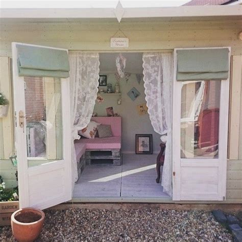 she sheds pinterest lacy curtains and feminine decor make this she shed a
