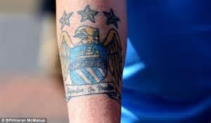 man city unveil new club crest ahead of premier league