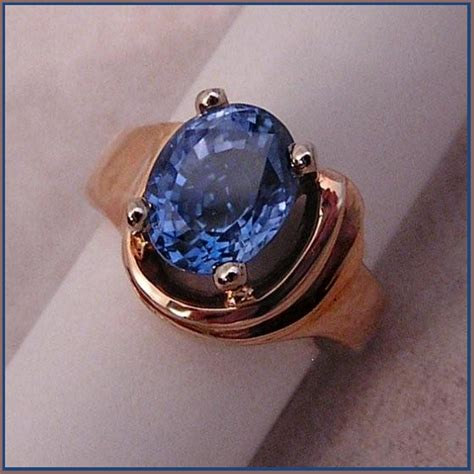 Light Sapphire Ceylon 4 17 carat ceylon blue sapphire set in 14 karat yellow gold