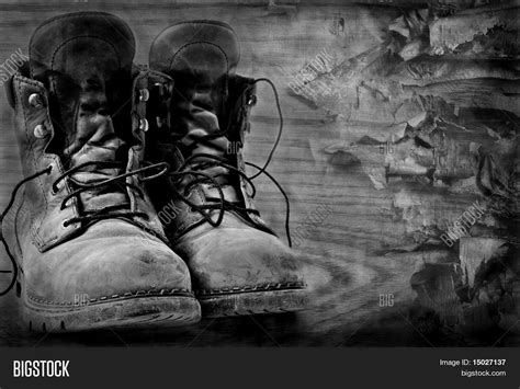 rugged background artistic black and white image of rugged boots on wood textured background stock photo stock
