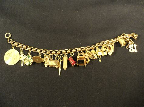wonderful 14k gold charm bracelet w 17 misc theme
