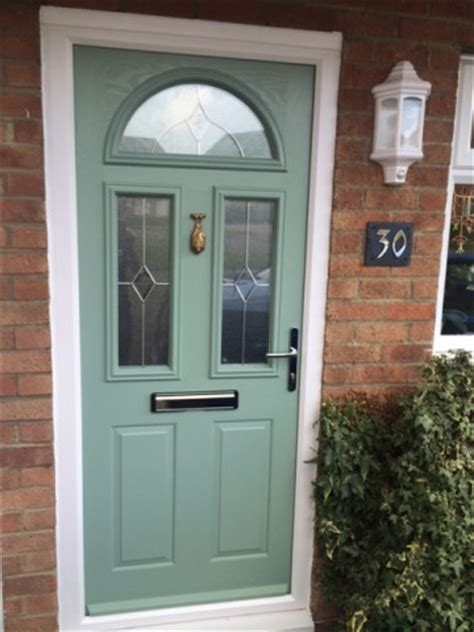 pale green composite front door apartment list front doors the pros and cons of a wood