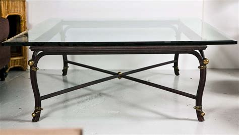 large bronze base coffee table with beveled glass top at