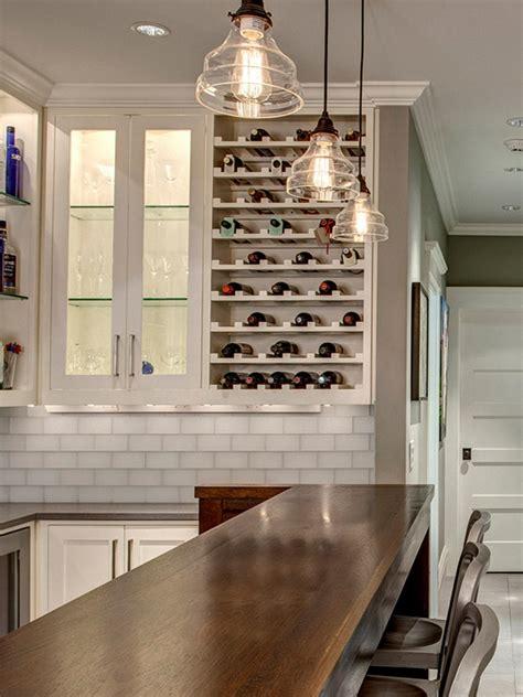 stylish transitional basement bar with builtin wine