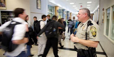 School Officer by Gun Charlottesville Albemarle Confront School