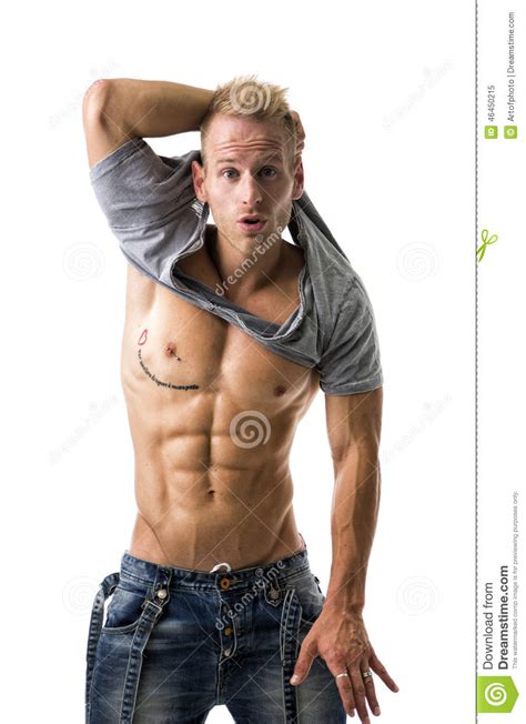 best stock photos of photo handsome man showing cell phone black handsome young athletic man showing sexy abs stock photo