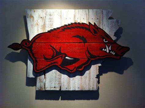 wooden state of arkansas with razorback logo nature