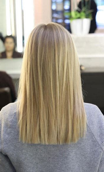blonnde blunt cut brunette highlights and long layers neil george