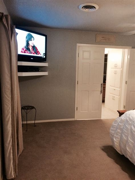 tv mounted on wall in bedroom 17 best ideas about tv mounting on pinterest wall