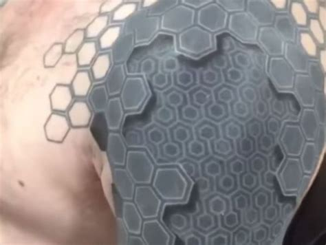 3d tattoo hexagons incredible 3d tattoo appears to pop off this man s arm