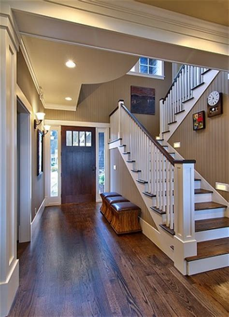 oak floors with walnut stain against simple white trim the wall color painted bead