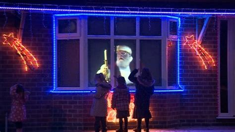 bbc news derby s holographic father christmas draws crowds
