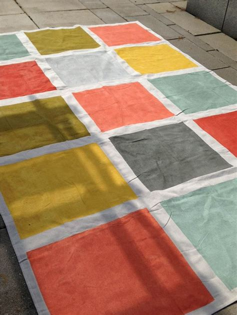 diy painted canvas rug this weekend s diy a rug made from a 6x9 canvas drop cloth painters and seven different