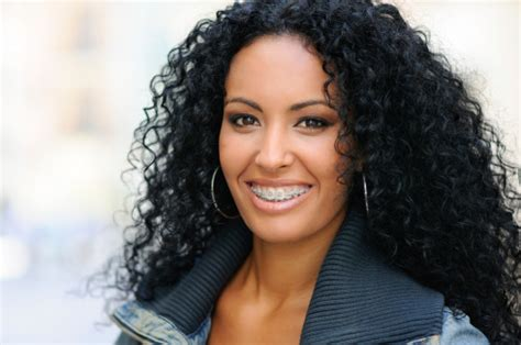 hairstyle for overbite happy black girl with braces stock photo thinkstock