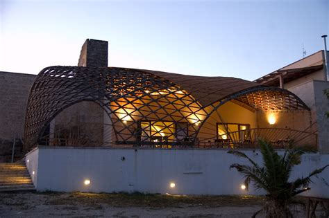 Gridshell s parametrically designed canopy shades masseria ospitale restaurant in lecce italy