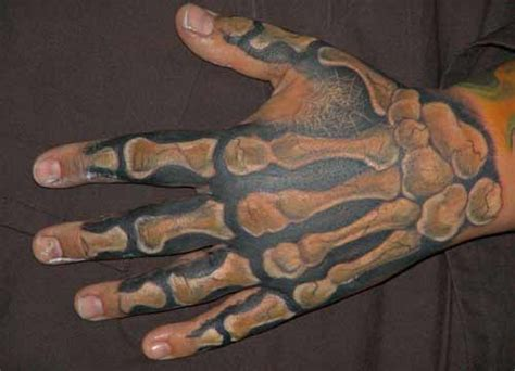 x tattoo on right hand skeletal hand by anthony lawton tattoonow