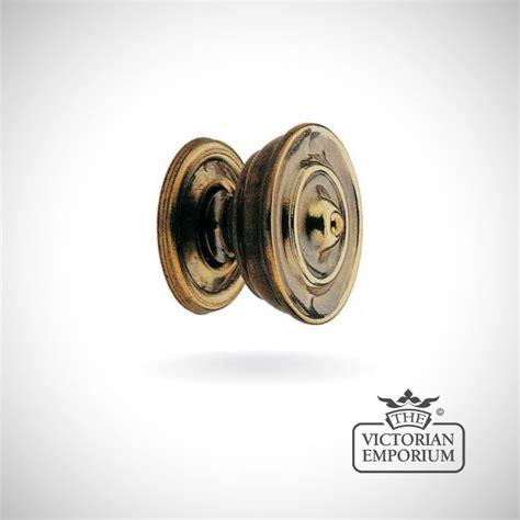 plain cupboard knob in antique brass knobs