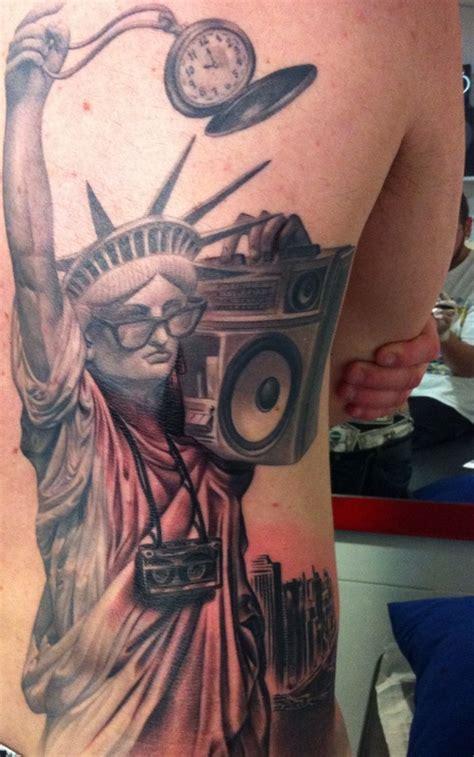 tattoo hell nyc new york life statue of liberty back tattoo tattoos