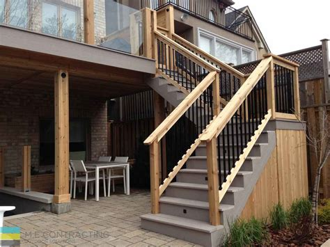 deck with walkout basement designs pvc deck with glass railings and walkout basement