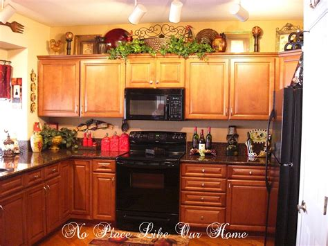 ideas for top of kitchen cabinets ideas for decorating above kitchen cabinets for christmas