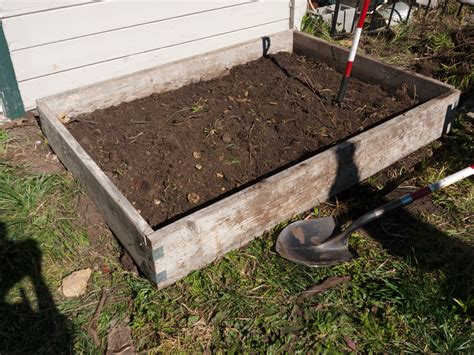 How To Build A Raised Garden Bed With Sleepers by How To Build Raised Garden Beds If You Re Cheap And Lazy