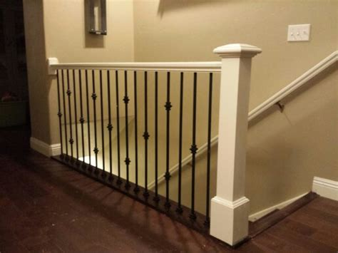 black banister white spindles antique white railing and post with black iron balusters that we built in a home in