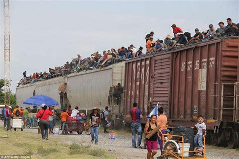 central americans pictured climbing aboard la bestia