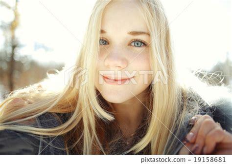 blonde teen winter portrait of a cute blonde teen stock photo