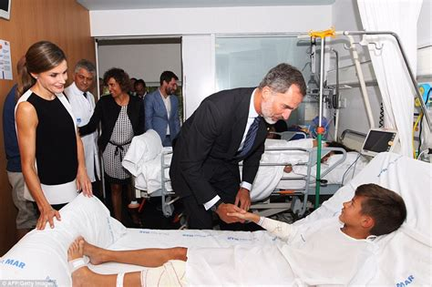 laying in bed in spanish spain s king felipe vi and queen letizia visit victims